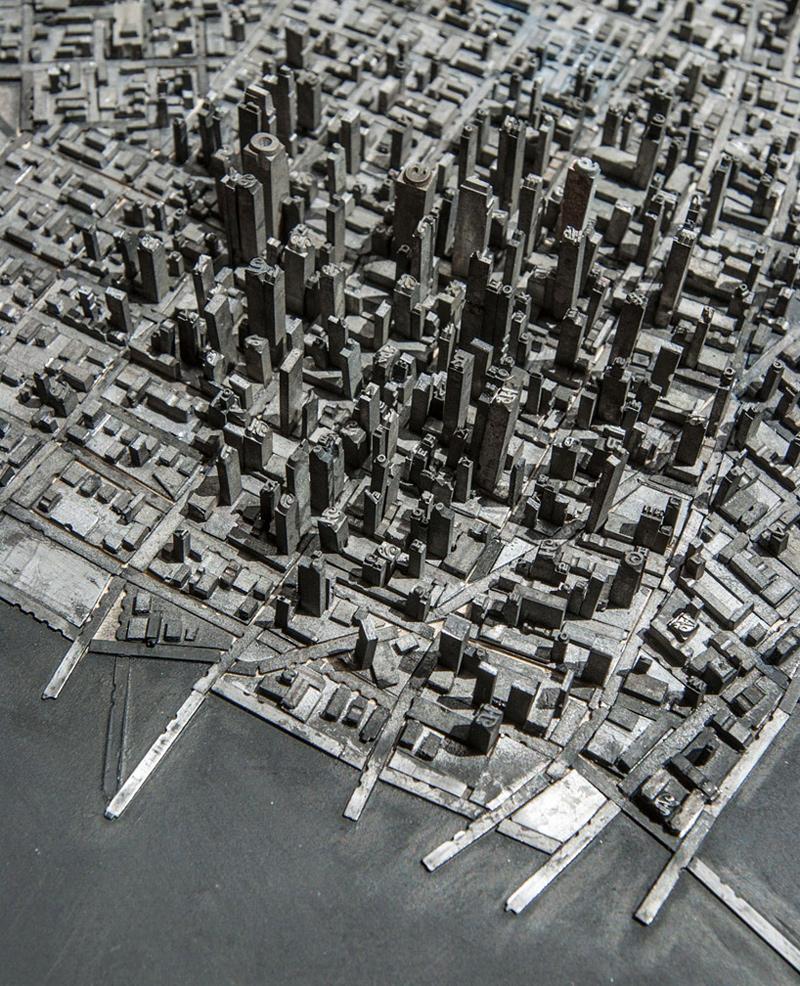 ville miniature en caractères d'imprimerie métalliques