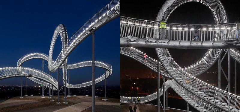 sculpture en forme de passerelle qui ressemble à des montagnes russes